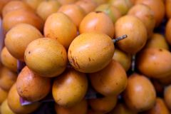 Granadilla fruit, or Passiflora ligularis in a farmers produce market royalty free stock image
