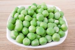 Fresh sweet green peas. Plate of fresh sweet green peas close-up Stock Photos