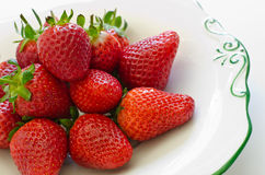 Fresh sweet and juicy red strawberries. Sweet and juicy summery red strawberries on a decorative plate ready to eat Royalty Free Stock Photo