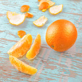 Fresh Sweet Orange Fruit and Peel on Rustic Wood Background Stock Images