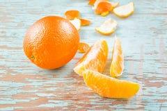 Fresh Sweet Orange Fruit and Peel on Rustic Wood Background Royalty Free Stock Photos