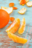 Fresh Sweet Orange Fruit and Peel on Rustic Wood Background Stock Image
