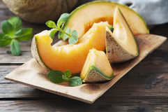 Fresh sweet orange melon and green mint Stock Photo
