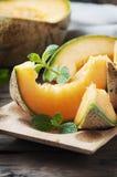 Fresh sweet orange melon and mint Stock Photo