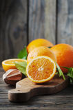 Fresh sweet oranges on the wooden table Stock Photos