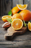 Fresh sweet oranges on the wooden table Royalty Free Stock Image