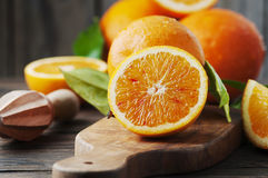 Fresh sweet oranges on the wooden table Royalty Free Stock Photos