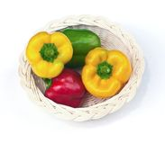 Fresh sweet  paprika in wood basket. Stock Image