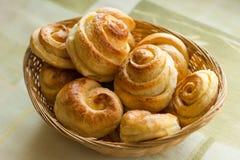 Fresh sweet pastries on the kitchen table closeup.  Stock Photos