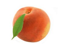 Fresh sweet peach with green leaf isolated on white Stock Image