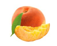 Fresh sweet peach with green leaf isolated on white Royalty Free Stock Image