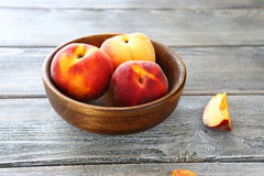 Fresh sweet peaches in a bowl Royalty Free Stock Images