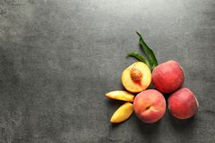 Fresh sweet peaches on table. Top view royalty free stock photo
