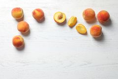 Fresh sweet peaches on wooden table. Top view royalty free stock photography