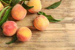 Fresh sweet peaches on wooden table. Top view stock photos