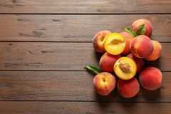 Fresh sweet peaches on wooden table. Top view stock photo