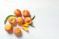 Fresh sweet peaches on wooden table. Top view stock image