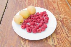 Fresh and sweet raspberries and Apricot Raspberry fruit background. Fresh fruit Stock Image