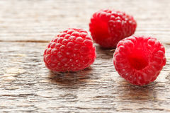 Fresh and sweet raspberries background. Selective focus.  Stock Images
