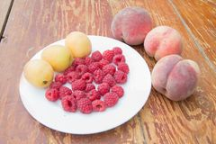 Fresh and sweet raspberries, Peach and Apricot Raspberry fruit background. Fresh fruit Stock Photography