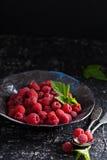 Fresh sweet raspberry in black bowl Royalty Free Stock Photos