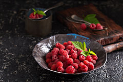 Fresh sweet raspberry in black bowl Stock Photo