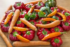 Red bell Peppers and carrots. Fresh sweet red bell Peppers and carrots Royalty Free Stock Photography
