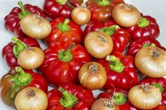 Red bell Peppers and onion. Fresh sweet red bell Peppers and onion Stock Photography