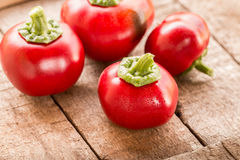 Fresh sweet red pepper on old wooden background. Food concept Royalty Free Stock Images