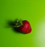 Fresh sweet strawberry on green stock photos