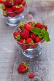 Fresh sweet strawberry in a transparent glass. On a natural background Royalty Free Stock Images
