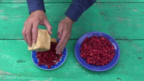 Fresh sweet summer raspberry in ceramic plate stock video