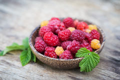 Fresh sweet tasty raspberries on wooden background Royalty Free Stock Images