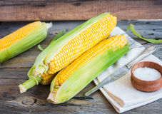 Fresh sweet yellow corn on wooden table, selective focus, closeu Stock Image