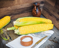 Fresh sweet yellow corn on wooden table, selective focus, closeu Royalty Free Stock Image