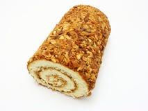 Fresh swiss roll with poppy on white. Fresh swiss roll with poppy isolated on white background Stock Image
