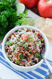 Fresh tabouleh salad. Fresh bulgur tabouleh salad in white bowl and ingredients royalty free stock image