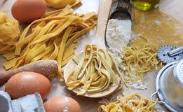 Fresh tagliatelle pasta homemade preparation. Fresh pasta home made preparation Royalty Free Stock Images