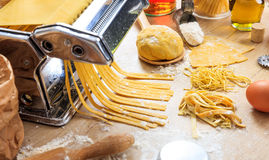 Fresh tagliatelle pasta homemade preparation. Fresh pasta home made preparation Royalty Free Stock Photo