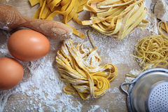 Fresh tagliatelle pasta homemade preparation. Fresh pasta home made preparation Stock Photo