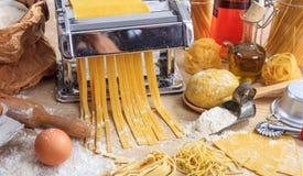 Fresh tagliatelle pasta homemade preparation. Fresh pasta home made preparation Stock Photography