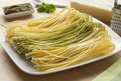 Fresh Tagliolini bicolore on a dish Stock Photos