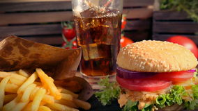 Fresh takeaway hamburger with cold drink and fries stock footage