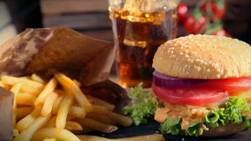 Fresh takeaway hamburger with cold drink and fries stock video footage