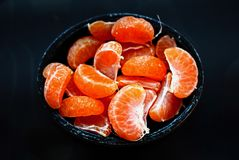 Fresh Tangerine. S, Tangerine in a black cup Royalty Free Stock Photo