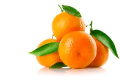 Fresh tangerine fruits with green leaves isolated Stock Photography