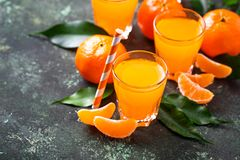 Fresh tangerine juice or liquor. Selective focus Stock Photography