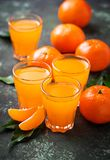 Fresh tangerine juice or liquor. Selective focus Stock Images