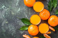 Fresh tangerine juice or liquor. Top view Stock Images