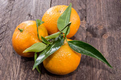 Fresh Tangerine with leaves. On wood Royalty Free Stock Photography